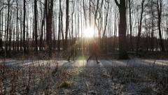 Couple running on path, winter/spring, sun Stock Footage