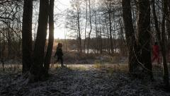Runner passing by, before people walk by, winter/spring Stock Footage