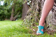 High heels in the park- copyspace Stock Photos