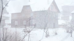 Snow in village Stock Footage