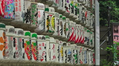 Stock Video Footage of Wall of Decorate Sake Barrels At The Meiji Jingu Shrine