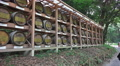 Wall of Wine Barrels At The Meiji Jingu Shrine Footage