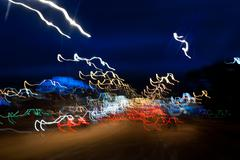 Cars driving motion night lights - stock photo