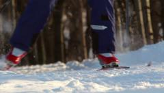 Cross-country skiing in the park close-up feet on a background of trees Stock Footage