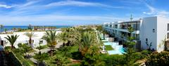Panorama of swimming pools at luxury hotel, Crete, Greece - stock photo