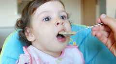 Little girl having lunch with baby food Stock Footage