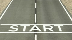 A starting line on a paved road - stock footage