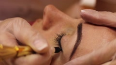 Permanent makeup, wear make up, eyeliner Stock Footage