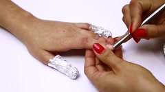 The process of removing gel nail Stock Footage