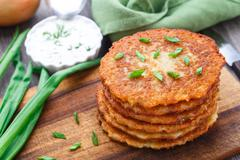Potato pancakes on a wooden board Stock Photos