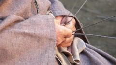 A man is weaving a wicker or gorse basket Stock Footage