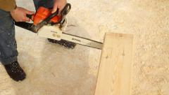 Carpenter to cut a groove in the wooden beam Stock Footage