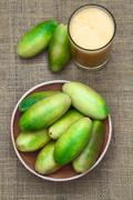 Banana Passionfruit (lat. Passiflora Tripartita) and Juice Stock Photos