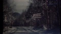 Driving window, snowy Adirondacks highway Stock Footage