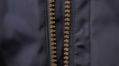 Closeup of zipper on man jacket with texture Stock Footage