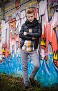 Fashion male portrait on graffiti wall Stock Photos