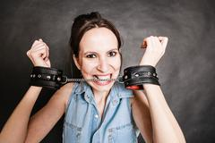Arrest and jail. Criminal woman prisoner girl in handcuffs - stock photo