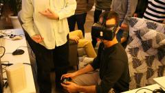A man plays virtual reality game using head mounted display Oculus Rift Stock Footage