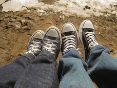 two peoples feet showing love and togetherness between them both - stock photo