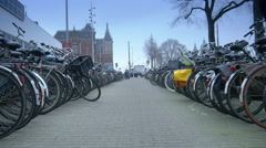 Bicycle racks at Central Station. Amsterdam, The Netherlands Stock Footage