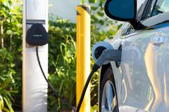 Electric car charging - stock photo