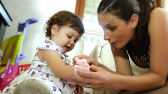 Mom and daughter playing with little peluche  Stock Footage