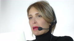beautiful  secretary is working with headphone microphone and computer - stock footage