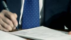 Businessman signs documents or agreement in his office Stock Footage