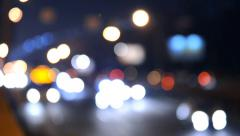 Defocused night traffic light in the city - stock footage