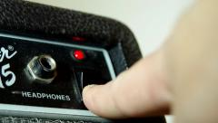 Turning on a  guitar amplifier Stock Footage
