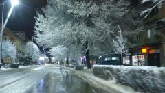 Driving Through The City At Night - Snow - Snow Covered City Stock Footage