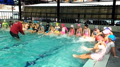 Children learning to swim - stock footage