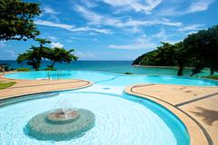 Infinity pool vacation on Boracay resort - stock photo