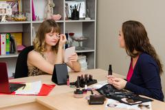 Client consultation on color shadows eyelids - stock photo