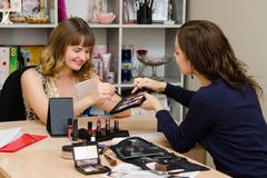 Stock Photo of Makeup artist recommends that when choosing a girl color eye shadow