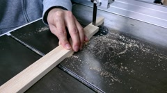 Man hand using electric saw machine sawing wood Stock Footage