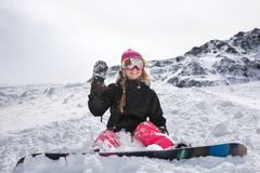 Joyful young woman snowboarder Stock Photos