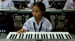 thai Children study piano in classroom - stock footage