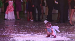 Little child wearing butterfly wings play at wedding party Stock Footage