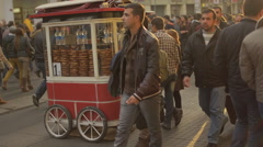 Time lapse simit seller trolley crowded commuter pedestrian car free zone Stock Footage