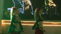 Female dancers dancing in spanish costume at indian wedding party Stock Footage