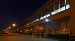 An establishing shot of a warehouse or factory at night. Stock Footage