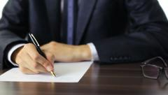 Businessman writing a formal letter Stock Footage