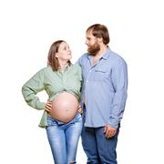 young family waiting for baby on a white background - stock photo