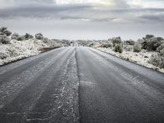 Snow on highway in arizona Stock Photos