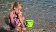 4K Child Playing Sea Beach Little Girl in Waves on Seashore Castle Bay Coastline Stock Footage