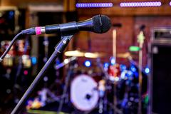 Closeup of microphone in the concert hall of nightclub Stock Photos