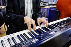 Hands pianist playing on digital piano in a jazz band closeup Kuvituskuvat