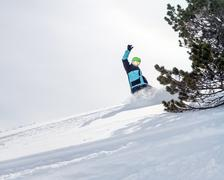 Freerider snowboarder moving down in snow powder Stock Photos