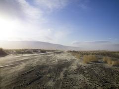 Dusty desert road Stock Photos